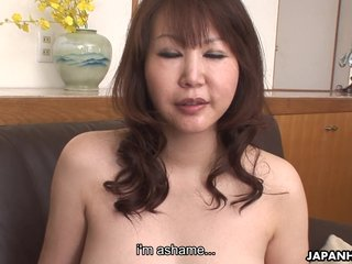 Hot Japanese MILF with big tits rides a hard