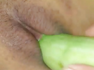 indonesian married couple with cucumber